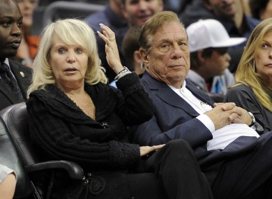 Los Angeles Clippers owner Donald T Sterling, right, sits with his wife Shelly.
