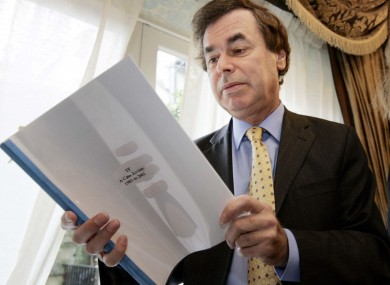 Former Justice Minister Alan Shatter reading a report - although not Guerin.