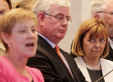 Phil Prendergast (left) speaks about her leader Eamon Gilmore (centre) as fellow MEP Emer Costello looks on.