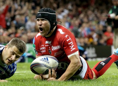Matt Giteau celebrates his first-half try in the 23-6 victory.