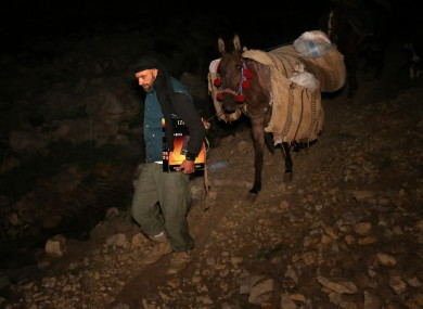 Ibrahim Abdulghani, 32, descends from the 2,814-metere Mount Hermon. He works as a construction worker during the day in Lebanon and volunteers at night to help Syrians escape.