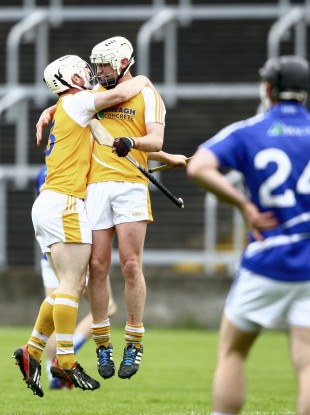 Antrim's Neal McAuley and Aaron Graffin celebrate at the final whistle.