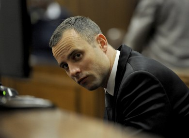 Oscar Pistorius sits in court for his ongoing murder trial in Pretoria.