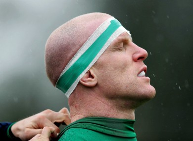 Ireland captain Paul O'Connell is fitted with his GPS and accelerometer device before training.