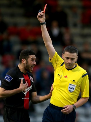 Bohs' Roberto Lopes is shown a straight red card by Referee Paul McLaughlin.