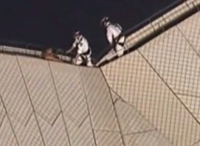Authorities attempt to coax the man from the roof of Sydney Opera House in Australia.