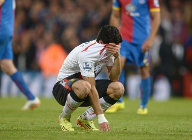 Luis Suarez covers his face at the end of Liverpool's 3-3 draw with Crystal Palace.