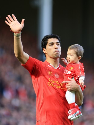 Luis Suarez salutes the Anfield crowd after the final game of the season.