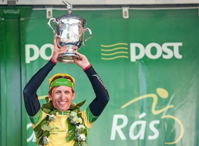 Overall race winner Clemens Fankhauser of Tirol Cycling Team UCI Continental Team Austria lifts the trophy.