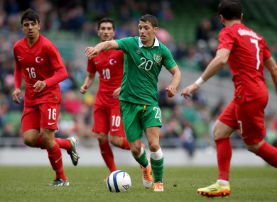 Hoolahan evades three Turkish players.