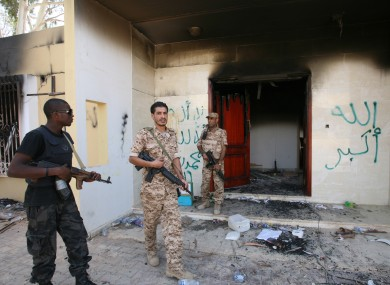 Libyan military guards check one of the U.S. Consulate's burnt out buildings.
