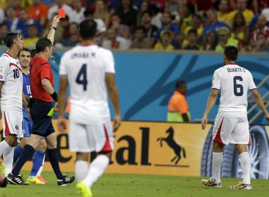 Benjamin Williams from Australia shows a red card to Costa Rica's Oscar Duarte.
