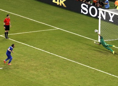 Keylor Navas makes the crucial save from Greece's Fanis Gekas.