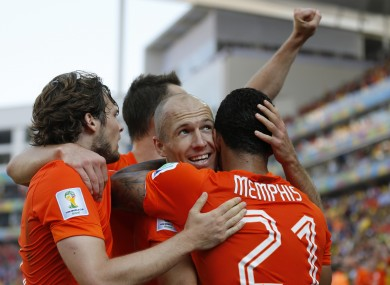 Goalscorer Memphis Depay is congratulated by Arjen Robben.