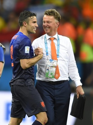 Netherlands' Robin van Persie, left, celebrates with head coach Louis van Gaal.