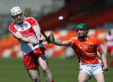 Daniel Mone with Dermot O'Neill in action in the Athletic Grounds.