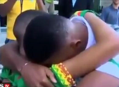 Samuel Eto'o hugs a distraught Cameroon fan.