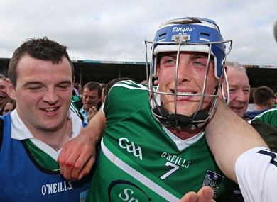 Limerick's Gavin O'Mahony is congratulated by supporters on the pitch after Sunday's game.