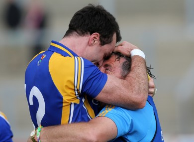 Longford's Paul Barden celebrates with manager Jack Sheedy.