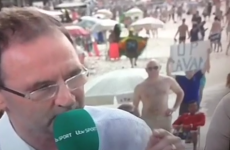 Martin O'Neill photobombed on the Copacabana by man with an 'Up Cavan' sign
