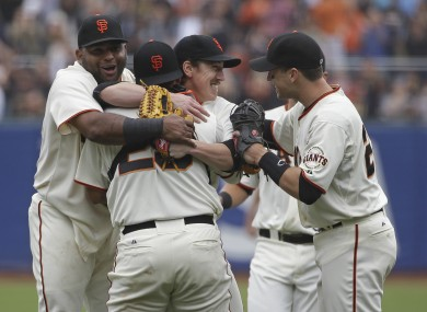 Tim Lincecum is mobbed by his Giants teammates.