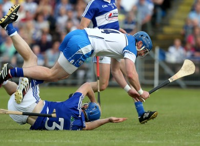 Waterford's Shane Walsh with Brian Campion of Laois.