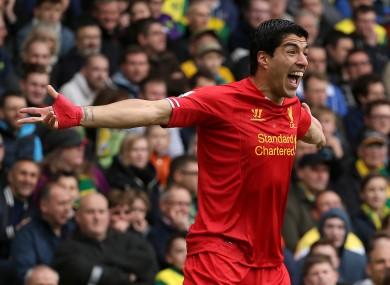 Suarez celebrates one of his 31 league goals last season.