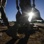 South Dakota National Guard troops fill sandbags in preparation for flooding along the Big Sioux River.<span class=