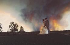 A couple used a raging wildfire as a backdrop for this amazing wedding photo