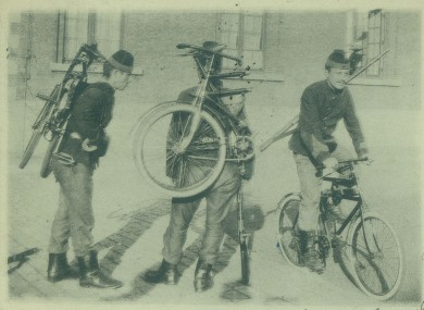 Belgian World War I soldiers with their foldable bicycles in Belgium during wartime.