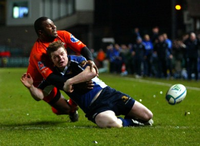 Rupeni Caucaunibuca knocks the ball loose from Brian O'Driscoll to prevent a try.