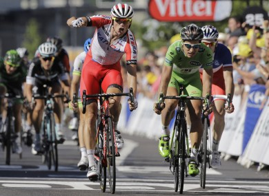 Kristoff punches the air in celebration after beating Sagan to the line.