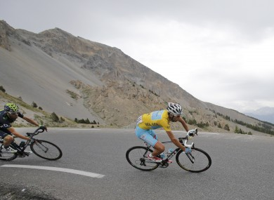 Italy's Vincenzo Nibali, wearing the overall leader's yellow jersey, and Spain's Alejandro Valverde, left, speed down Izoard pass.
