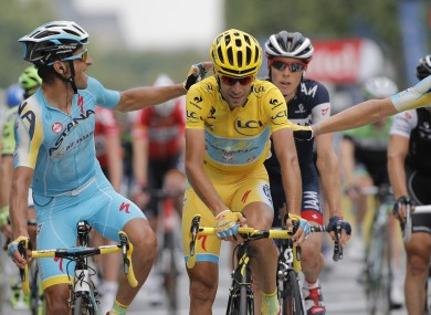 Italy's Vincenzo Nibali, centre, is congratulated by teammates as he crosses the finish line.