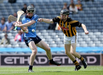 Conor Delaney tries to get a block in on Dublin's Eoghan McHugh.