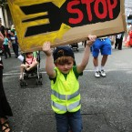 Jack Aronson, 4, from Dublin, takes part in a protest march through Dublin city centre to call for an end to Israeli military action in Gaza and