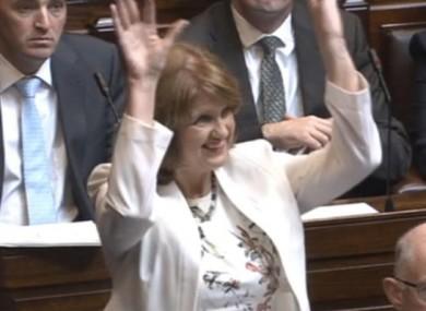 Tánaiste Joan Burton welcoming members of the deaf community in the Dáil gallery with a wave on Thursday