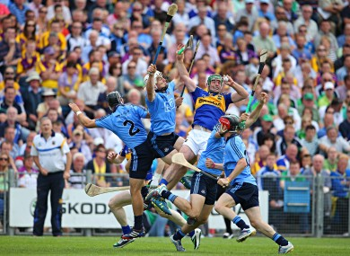 Tipperary's John O'Dwyer with Shane Durkin, Liam Rushe and Michael Carton of Dublin.