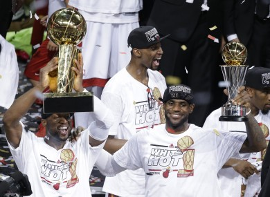 Dwyane Wae, LeBron James and Chris Bosh celebrate their 2013 NBA finals win.