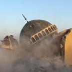 A bulldozer destroys Sunni's Ahmed al-Rifai shrine and tomb in Mahlabiya district outside of Tal Afar, Iraq.<span class=