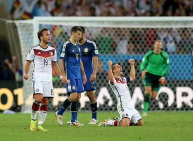 Germany's Philipp Lahm (centre) and Mario Gotze celebrate the win after the final whistle.