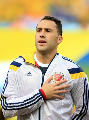 Ospina sings the Colombia anthem during the World Cup.