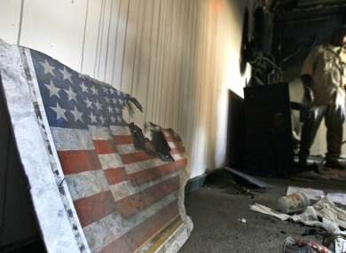 A US embassy flag inside the embassy in Tripoli on 12 September 2011