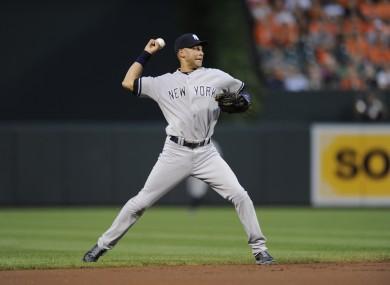 New York Yankees shortstop Derek Jeter throws to first.