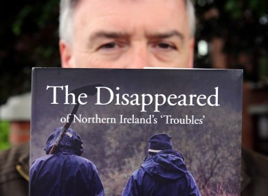 Kieran Megraw, brother of one of the Disappeared, Brendan Megraw with a book about the families' experiences.