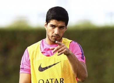 Barcelona forward Luis Suarez this morning.
