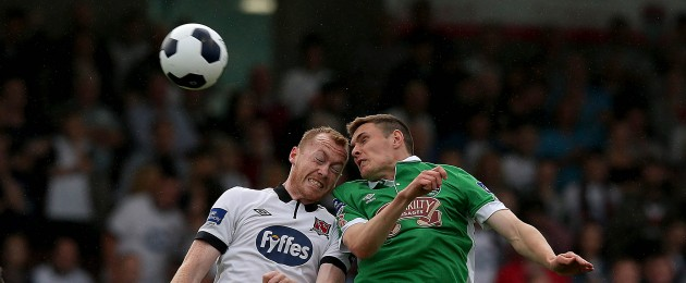 Chris Shileds of Dundalk with Garry Buckley of Cork battle for the ball.