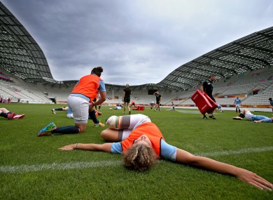 Ireland warm-up for their captain's run at Stade Jean-Bouin yesterday.