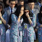Malaysia Airlines crew members cry during a hand-over ceremony of bodies of the downed Flight MH17, at Kuala Lumpur International Airport in Sepang, MalaysiA. <span class=