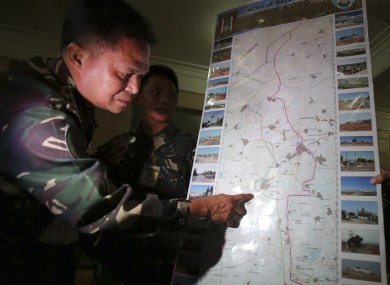 Philippine military chief Gen. Gregorio Pio Catapang shows reporters where Filipino peacekeepers in Golan Heights have been repositioned.